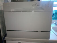 Compact tabletop dishwasher, like new, still on its warranty period