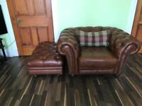 Brown leather 'chesterfield style' armchair and footstool.