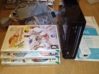 Nintendo Wii with 3 games - MySims Kingdom, Petz Sports, Cooking Mama + Controller and Nunchuk