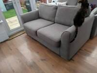 Grey two-seater sofa