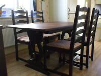 Extending table and 4 chairs. Chairs have been upholstered Collection is WSM.