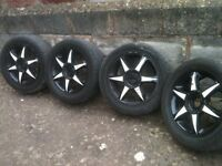 for sale my ford cougar alloys 215=55=16 with 4 good tyres and r v/good tyres £60.00 ono whitchurch