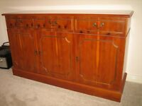 3 drawer and cupboard sideboard in yew finish in very good condition