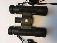 Leica Ultravid 10x25 light weight binoculars. Never used. Excellent condition.