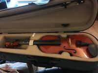 Child's violin with case and bow
