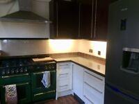 Crown kitchen units and corian worktop