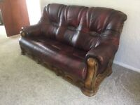 Burgundy leather and wood three piece suite