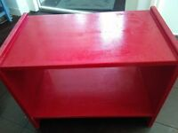 Bedside table in red