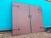 Wooden garage door on metal frame