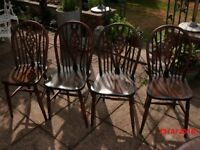 Priory Oak dining table and 4 wheel back chairs