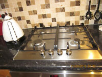 Bosch electric multi function oven and gas hob. In good working condition. Guildford - 01483613985