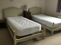 Pair of antique painted wooden single beds plus new mattresses