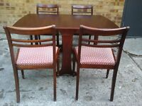 Dark wood folding table and 4 chairs hardly used