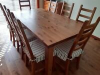 Solid Wood Dining Table and 8 matching chairs