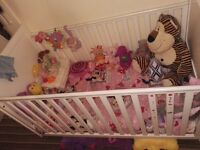 White cot... good condition and also cums with the matteress and mini mouse bedding and quilt