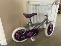 Used girls bike with stablizer for sale