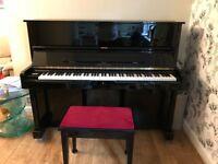 Black upright Reid-Sohn piano