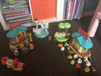 A bundle of happyland play sets and characters
