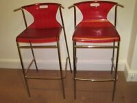 Two Ikea Elmer Red Perspex and Chrome Stackable Bar Stools with footrest and comfortable back