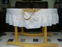 Moses basket with mattress and 3 fitted sheets.