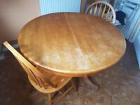 Extending dining table with 2 chairs