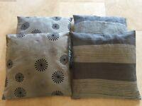 Bundle of four modern grey cushions