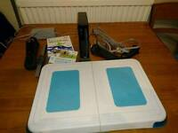 Wii console with Wii Fit board + games