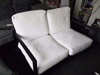 2 seater wooden frame white cushions sofa