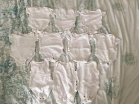 Bundle of white baby vests 0-3 months