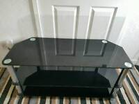 large black glass and chrome tv stand with 2 shelfs