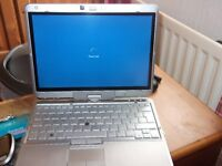 hp elitebook 2760p.i5 laptop/tablet touch screen i5,8gb ram.
