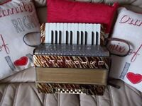 estrella accordion, beautiful condition for age, famous German make.