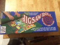 Jigsaw roll. Portable mat to do jigsaws on and then pack away or move them, even if unfinished.