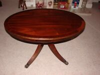 traditional oval maogany coffee table