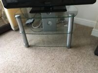 Nearly new glass TV stand. Perfect condition.