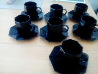 Black coffee cups and saucers