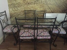 Glass/metal dining table with 6 chairs
