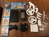 Excellent condition Wii U 32GB, 7 games, pro controller, charging station, 4 WiiMotes and more
