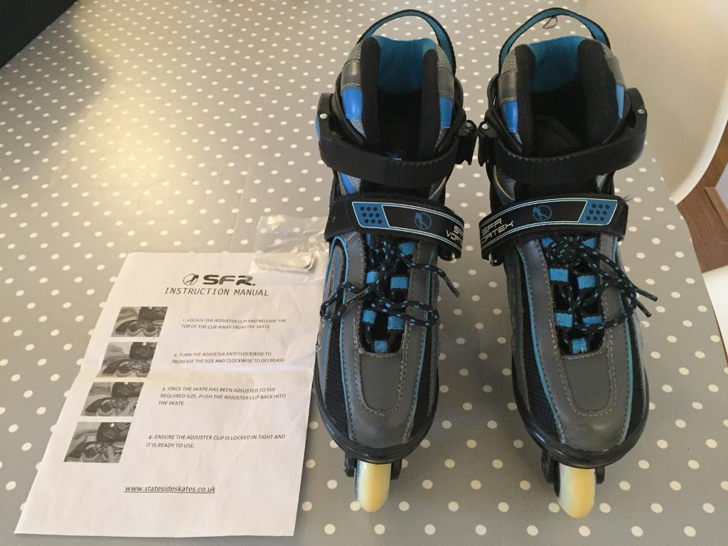 Adjustable inline skates. Size junior 12-adult 2.