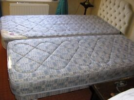TWO X 3 FT SINGLE BEDS ONE FOLDS DOWN TO BE STORED UNDER THE OTHER