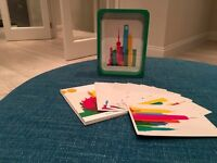 Photo frame with a set of colourful postcards for £25