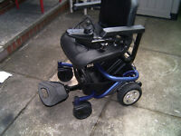 Travelux Quest Electric Wheelchair Splits Into 4 Pieces For Transportation