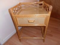 Lovely cane bedside table/hall table with glass top and drawer