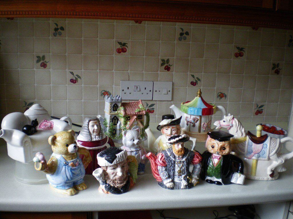 COLLECTION OF 11 ORNAMENTAL NOVELTY TEA POTS see all photos to view individuals