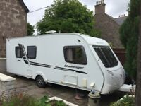 Swift Challenger 580 2010 4 berth Caravan with PowrTouch Motor Mover and Rare Island Double Bed