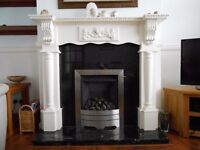 Black Granite fireplace with Mahogany fire surround