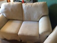 2 seater cream sofa and arm chair