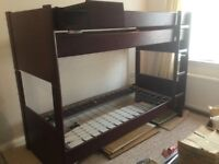 Mahogany bunk bed with ladders and storage shelf