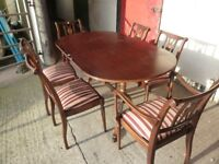 Large Dining Table with four Chairs and 2 Cavers Delivery Available