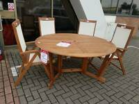 Wooden table and 6 Chairs (B)